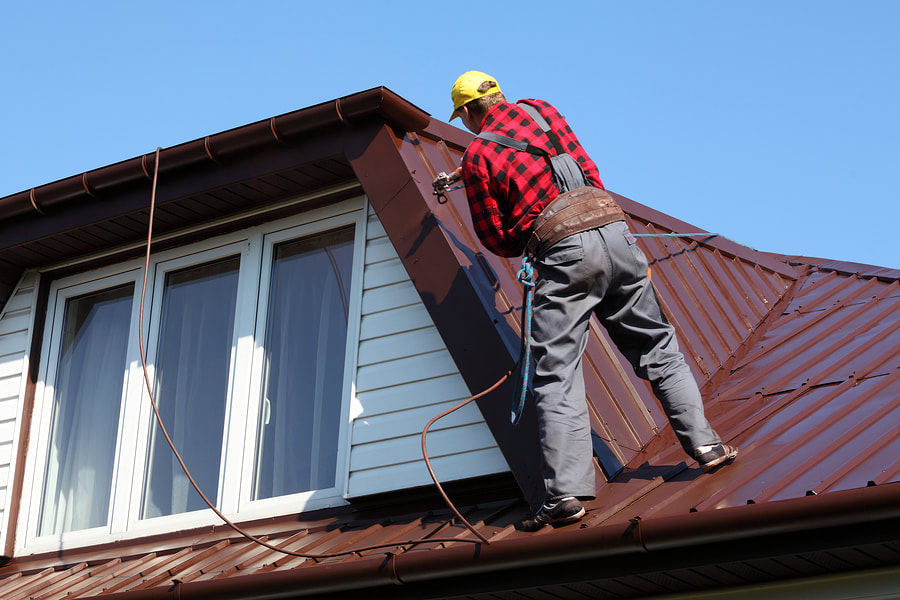 professional roofer doing roof repair