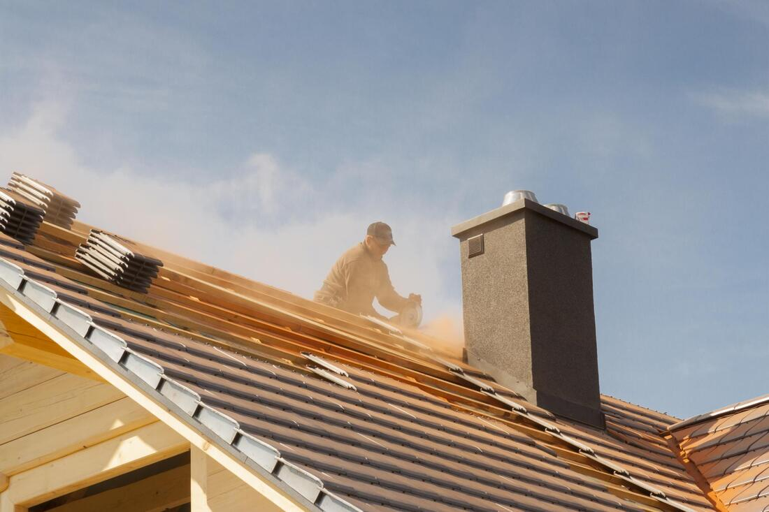 professional roofer installing metal roofing